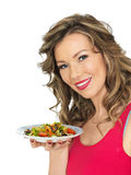 Young Woman Eating a Fresh Crispy Garden Salad Royalty Free Stock Images