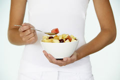 Young Woman Eating Fresh Fruit Salad Royalty Free Stock Photography