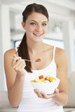 Young Woman Eating Fresh Fruit Salad Stock Photos