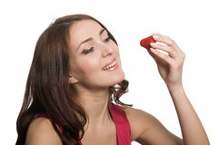 Young woman eating a fresh red strawberry Royalty Free Stock Images