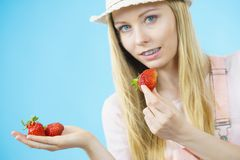 Young woman with fresh strawberries. Young woman eating fresh strawberries fruits. Healthy meal Stock Image