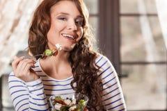 Young woman eating fresh vegetable salad Stock Image