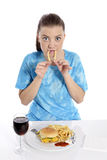 Young woman eating fries Stock Images