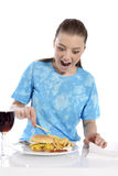 Young woman eating fries Royalty Free Stock Photography