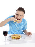 Young woman eating fries Stock Photography