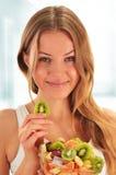 Young woman eating fruit salad. Balanced diet Stock Image