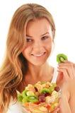 Young woman eating fruit salad Stock Image