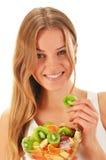 Young woman eating fruit salad Stock Photos