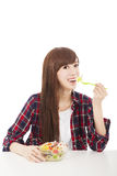 Young woman eating fruits and salad Stock Photo