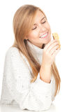 Young woman eating granola bar Stock Images