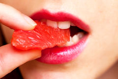 Young woman eating grapefruit Royalty Free Stock Image