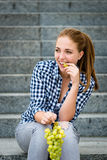 Young woman eating  grapes Stock Photos