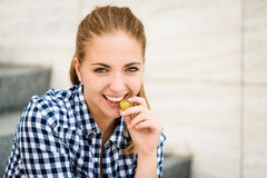Young woman eating  grapes Stock Photo
