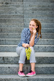 Young woman eating  grapes Royalty Free Stock Image