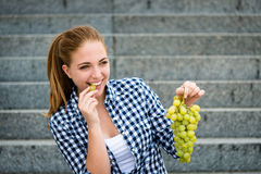 Young woman eating  grapes Stock Image