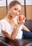 Young woman eating green apple Royalty Free Stock Photos
