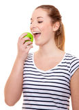 Young woman eating green apple Royalty Free Stock Photography