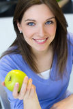Young woman eating green apple. Stock Photography