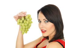 Young Woman Eating Green Grapes Stock Photography