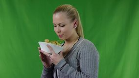 Young woman eating the green grapes stock footage