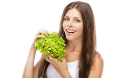 Young woman eating green salad Stock Photography
