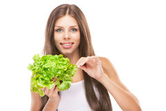Young woman eating green salad Royalty Free Stock Photo
