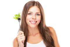 Young woman eating green salad Royalty Free Stock Photography