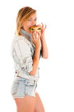 Young woman eating a hamburger Royalty Free Stock Photo