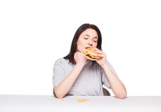 Young woman eating hamburger isolated on white Royalty Free Stock Photo