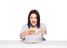 Young woman eating hamburger isolated on white stock photo