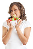 Young woman eating healhty salad Royalty Free Stock Photos