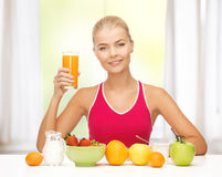 Young woman eating healthy breakfast Stock Photos