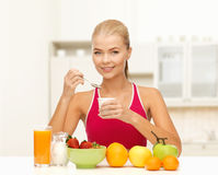 Young woman eating healthy breakfast Stock Images