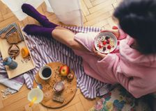 Young woman eating healthy breakfast. Young woman eating healthy breakfast, early in the morning stock photos
