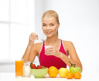 Young woman eating healthy breakfast Stock Photo