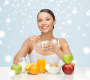 Young woman eating healthy breakfast. Food, nutrition, slimming, diet concept - woman eating healthy breakfast Stock Photo