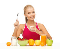 Young woman eating healthy breakfast. Picture of young woman eating healthy breakfast Royalty Free Stock Images