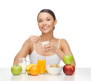 Young woman eating healthy breakfast Royalty Free Stock Image