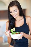 Young woman eating a healthy fresh salad Royalty Free Stock Photos