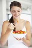 Young Woman Eating A Healthy Salad Royalty Free Stock Photo