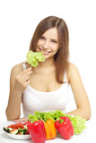 Young woman eating healthy salad on white Stock Photo