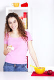 Young woman eating her breakfast Stock Photography
