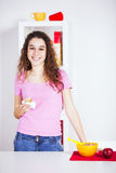 Young woman eating her breakfast Royalty Free Stock Photography
