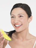 Young Woman Eating Honeydew Melon Stock Images