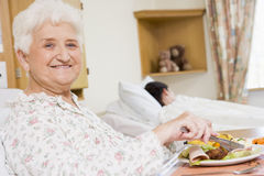Young Woman Eating Hospital Food royalty free stock photo