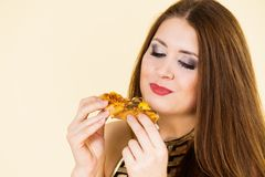 Woman eating hot pizza slice stock image