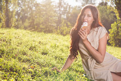 Young woman eating ice cream Royalty Free Stock Photo