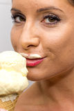 Young woman eating ice cream Stock Photography