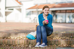 Young woman eating ice cream in summer park. Stock Images