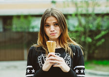 Young woman eating ice-cream sunny day outdoors Stock Image